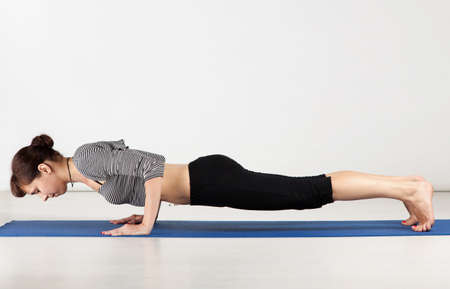 Young woman exercising yoga in a gym Stock Photo