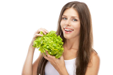 Young woman eating green salad, isolated on white background photo