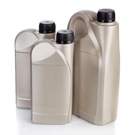 motor oil: Motor oil containers Stock Photo