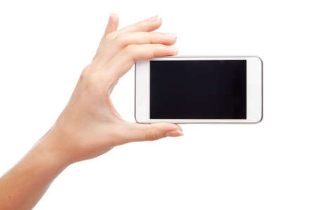 woman holding sign: Female hand holding a modern smartphone
