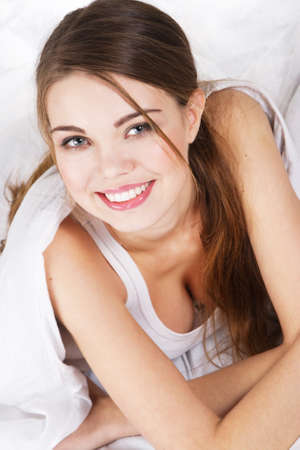 Young beautiful woman resting in bed photo