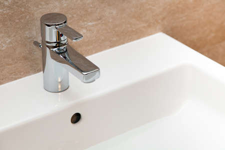 Modern water faucet photo