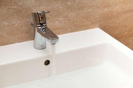 Modern water faucet photo