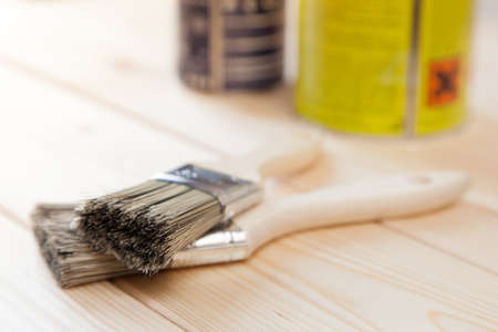 Paint brushes on wooden planks photo