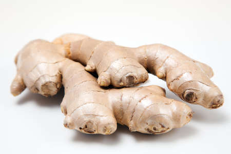 Fresh ginger root on white background photo