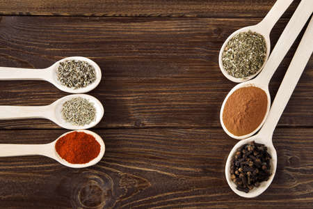 Spice assortment on a wooden table photo