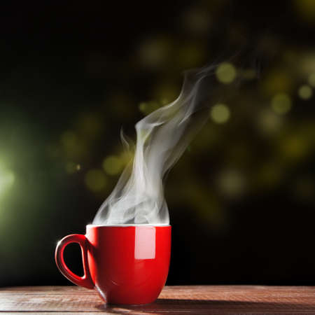 Steaming coffee cup on dark background Stock Photo