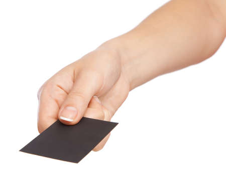 Hand holding a black business card photo