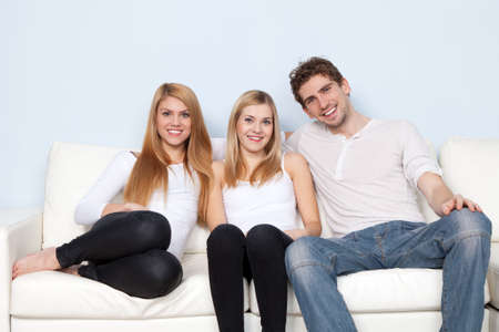 Group of young people on a sofa photo
