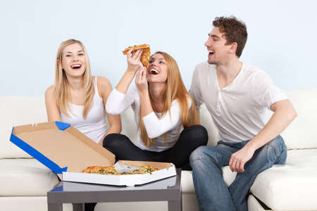 hanging woman: Group of young people eating pizza at home