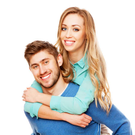 Young beautiful couple isolated on white background photo
