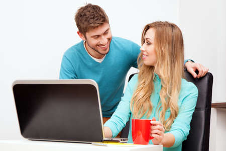 Young couple working with laptop photo