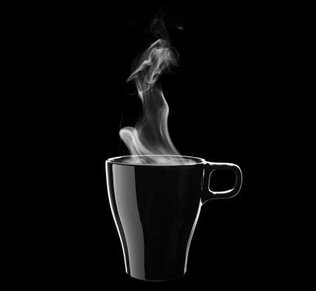 Black coffee cup isolated on black background photo