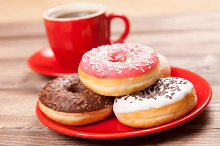 Tasty donut with a cup of coffee photo