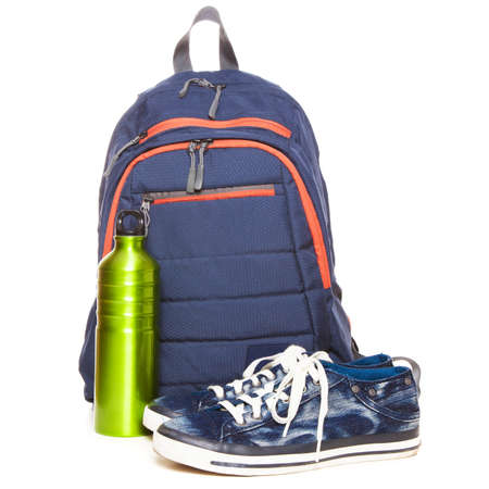 Backpack and sneakers on white background photo