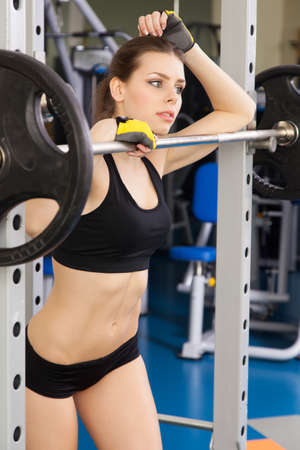 Young slim woman exercising in a gym photo
