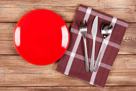 Red plate on a wooden table photo