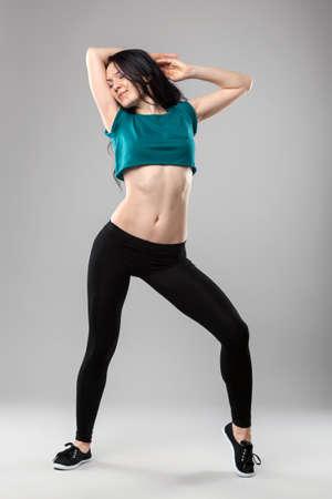 Professional dancer in studio on grey background photo