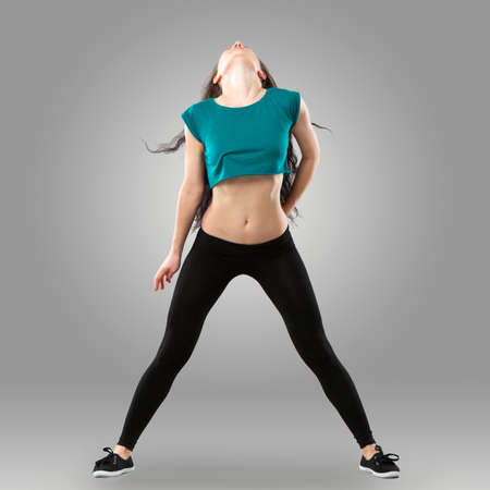 leggings: Professional dancer in studio on grey background
