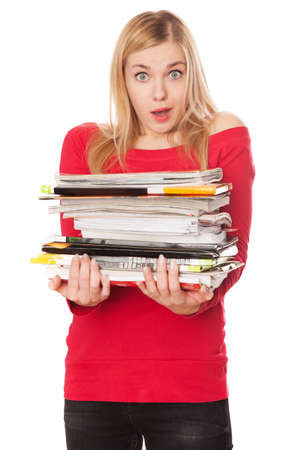 Student girl with a pile of heavy books, white background photo