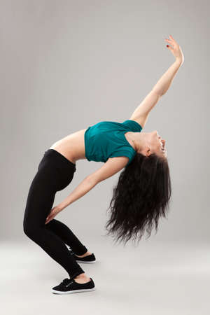 Professional dancer in studio on grey background photo