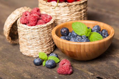 Fresh berries on a wooden table photo