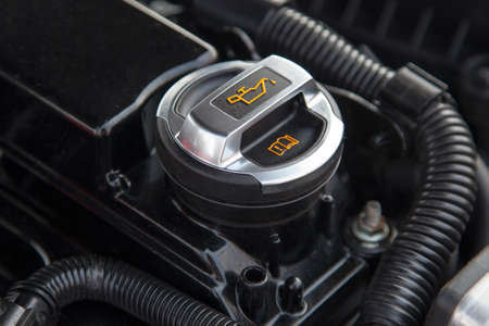 new motor vehicles: Motor oil cap under the hood of a car