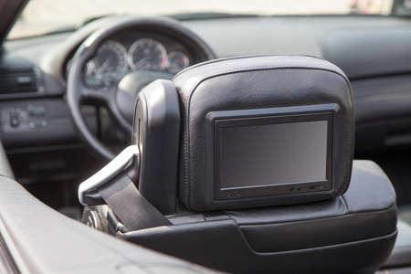 back seat: Multimedia backseat screen in a luxury car