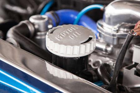 Motor oil cap under the hood of a car photo