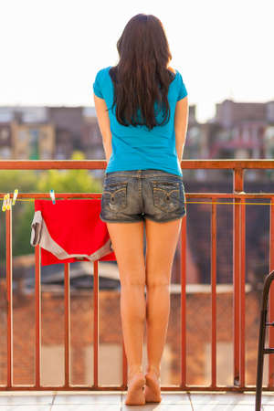 Young woman on her balcony photo