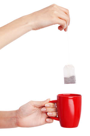 Female hand holding a cup on white background photo
