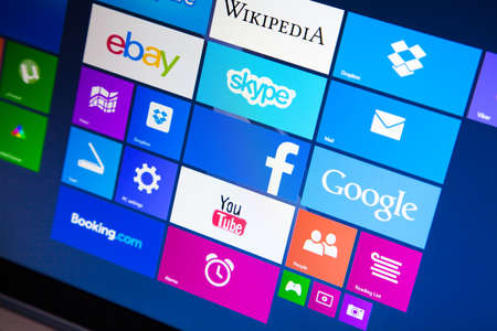 store window: WROCLAW, POLAND - AUGUST 26, 2014: Photo of a Windows 8.1 operated laptop - start screen with most popular apps Editorial