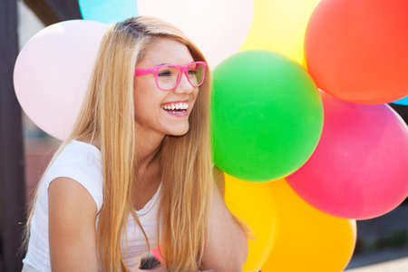 Young beautiful woman with colorful balloons photo