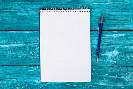 Blank notepad on blue painted wood photo