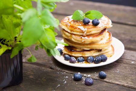 Delicious pancakes with blueberry and mint photo