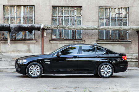 the series: KIEV, UKRAINE - JULY 27, 2012: Side view of a 7 series BMW car