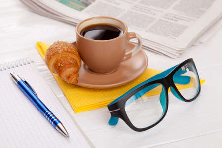 worktable: Coffee with croissant on a worktable Stock Photo