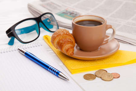 Coffee with croissant on a worktable photo