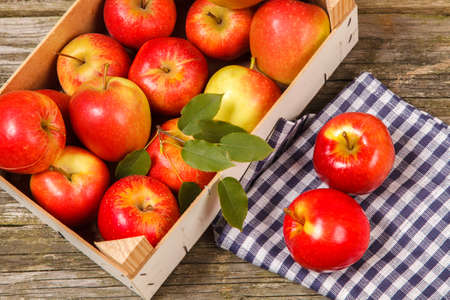 Fresh red apples on wooden table photo