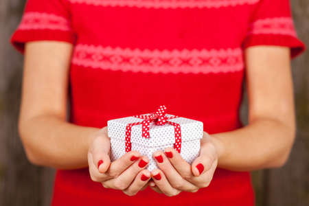 Female hands holding a present box photo