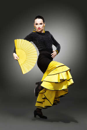 Flamenco dancer in a yellow skirt photo