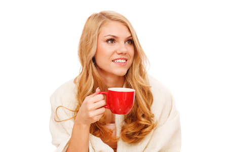 Young woman relaxing with a cup of coffee photo