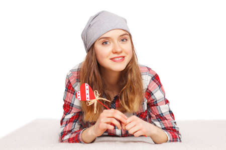 teenage girl: Portrait of a teenage girl with a heart symbol in her hands