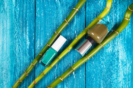 Nail polish on blue wood surface photo