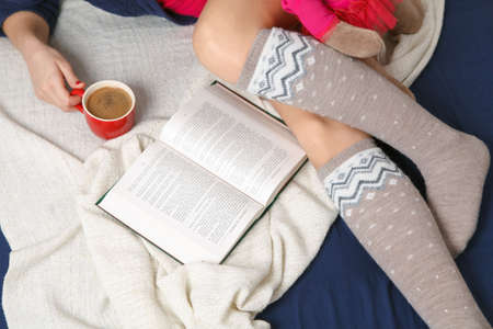 woolen: Female legs in warm woolen socks.
