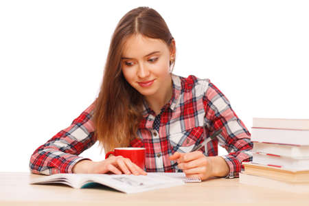 textbooks: Young girl reading her textbooks Stock Photo
