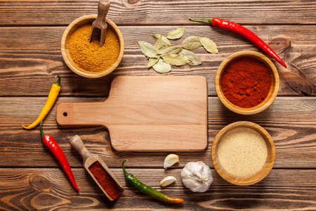 asian foods: Bowls with spices and a cutting board