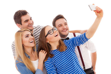 Four stylish young people maing a selfie photo