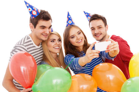 Group of young people having a birthday party, isolated on white background photo