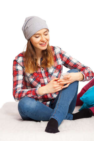 checked shirt: Teenage girl in a checked shirt with a smartphone